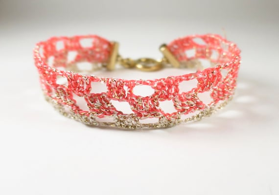 Beige and pink/orange fluorescent crochet open bracelet
