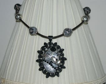 grey and black metal Medallion necklace