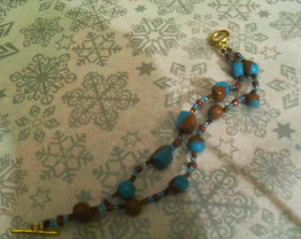 pretty bracelet made of polymer clay blue and Brown