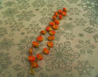 pretty bracelet made of polymer clay red and gold