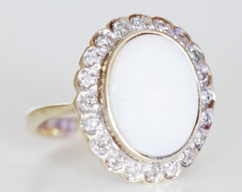 Precious Opal Ring with Diamonds in 8 Carat Gold