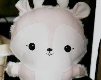 A cute cuddly stuffed deer