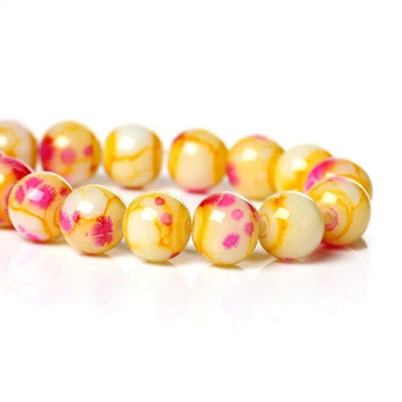 Set of 10 beads - yellow and pink - 8 mm