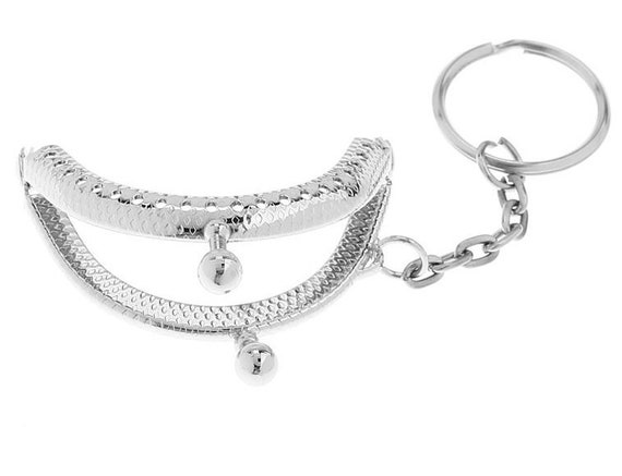 1 clasp purse - silver - size: 52 x 42 mm