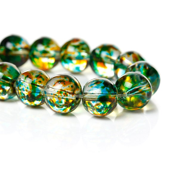 Set of 10 glass beads - green transparent with logo patch - 10 mm