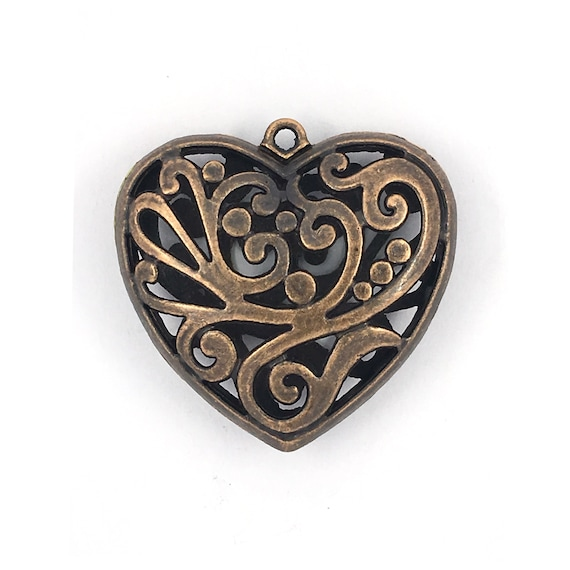 """Great charm - copper colored """"3D heart"""""""