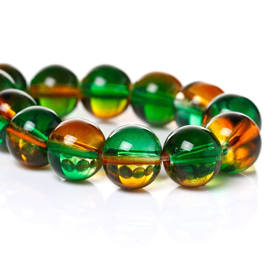 Set of 10 glass beads - green and orange transparent - 10 mm