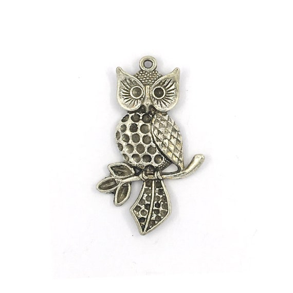 "Great charm - silver colored ""Owls"""