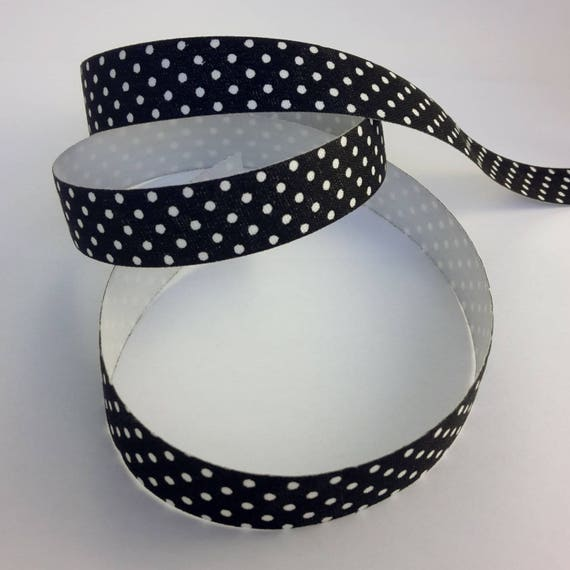 R - Tape on a black background with white dots - 10 mm wide