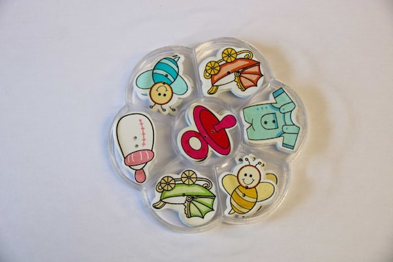child - assorted wood buttons