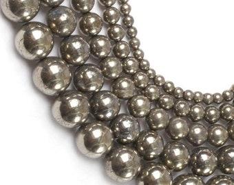 2pc Pyrite Dorée Goutte plate 12x8mm   4558550015761 Perles de Pierre