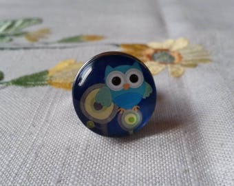 a button pressure 18 mm Lil OWL at the bottom blue (only 1 piece)
