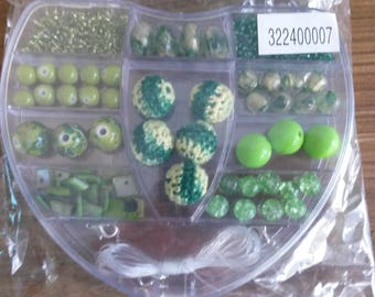 1 box with assorted green beads of different sizes