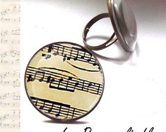 Old sheet music bronze with glass dome ring.