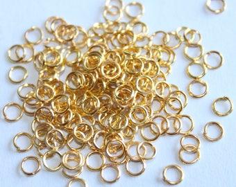 Golden 0.7* rings 4 mm, set of 100