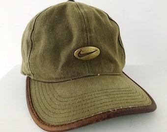 7b3f64a9e7a17 90s Vintage NIKE GOLF Olive Green Strap Back Hat   Metal Swoosh Logo Emblem