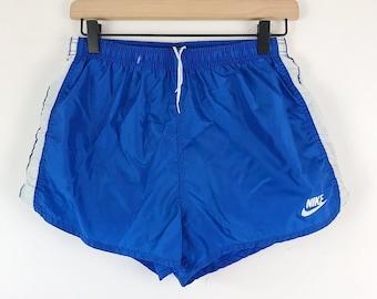 512ad03556 80s Vintage NIKE Blue Tag Women s Size Medium Nylon Running Shorts