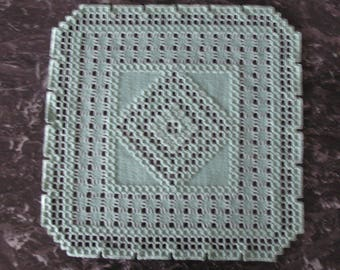 Pale green Hardanger embroidered doily