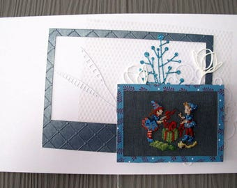 """Table """"package!"""" embroidered in blue-grey"""