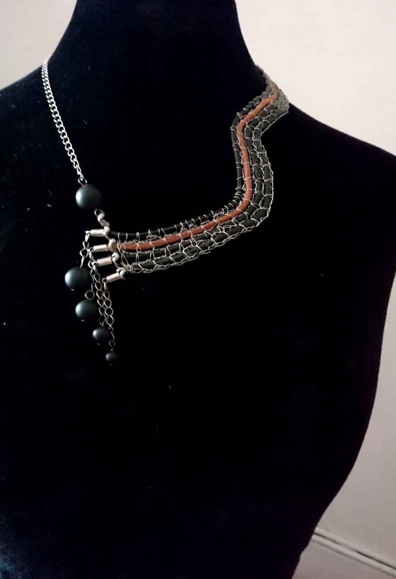 Asymmetrical leather collar and steel wire