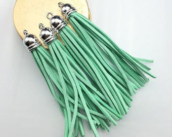 2 tassels, suede, turquoise blue color