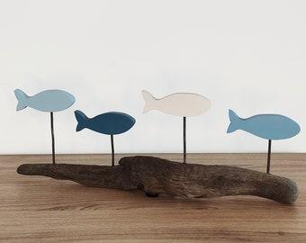 Decoration fish on driftwood base