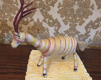 Vintage reindeer made of strings--gold browns off white retro