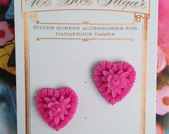 Carved celluloid heart earrings