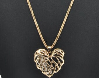 A nice necklace transparent crystals and filigree heart shape