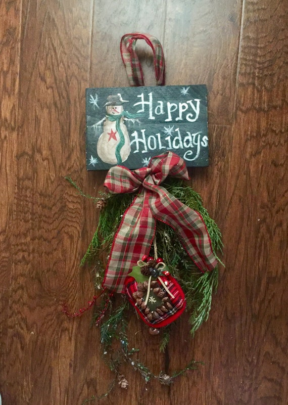 Farmhouse Christmas swag with snowman sign and fresh preserved evergreen