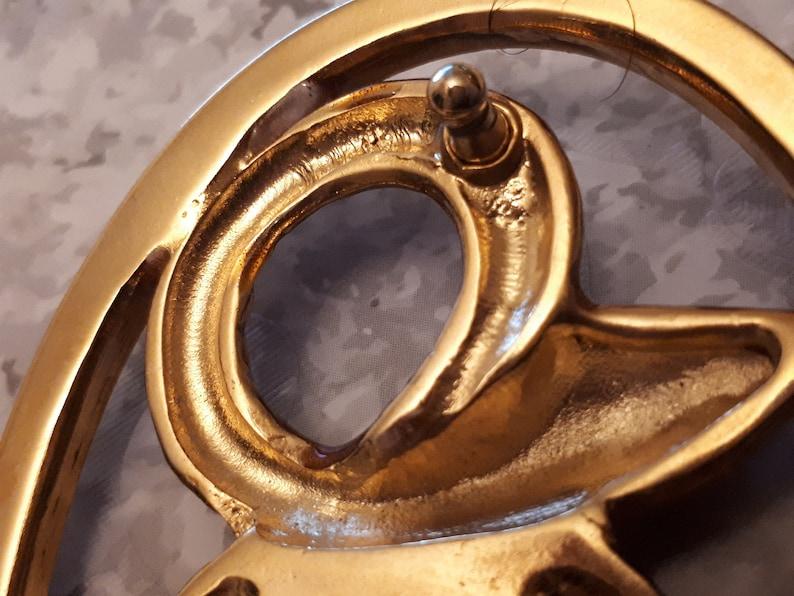 Golden snake belt buckle encrusted with rhinestones 85 x 65 mm
