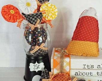 Decorative black gumball machine made of glass and metal components perfect for seasonal displays, tiered tray, and vignettes.