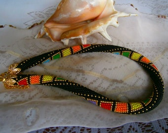 Necklace black background with small multicolored squares