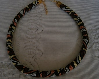 Crocheted spiral necklace with geometric patterns