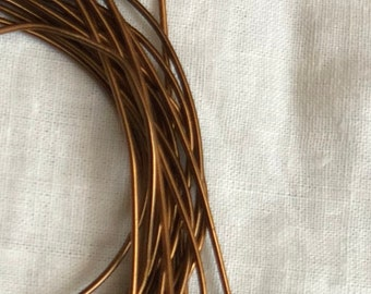 Golden brown smooth purl 1 mm