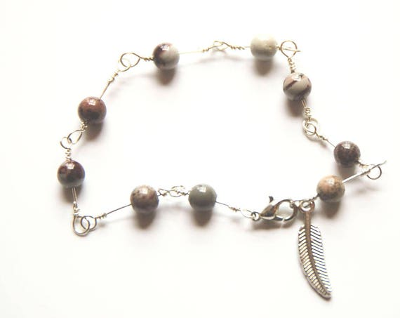 Delicate Sterling Silver bracelet with Coffee Bean Jasper Beads and Feather Charm.
