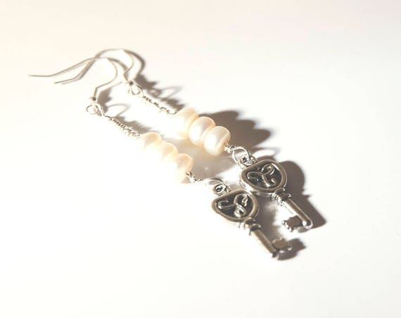 Freshwater pearl earrings on sterling silver wire, with Tibetan silver key charm on sterling silver hooks.