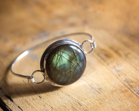 Breathtaking labradorite circle in sterling silver, on solid silver bangle