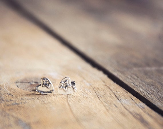 Hand-Fashioned Pure Silver Stud Earrings. Little hearts each embossed with stars. One of a kind.