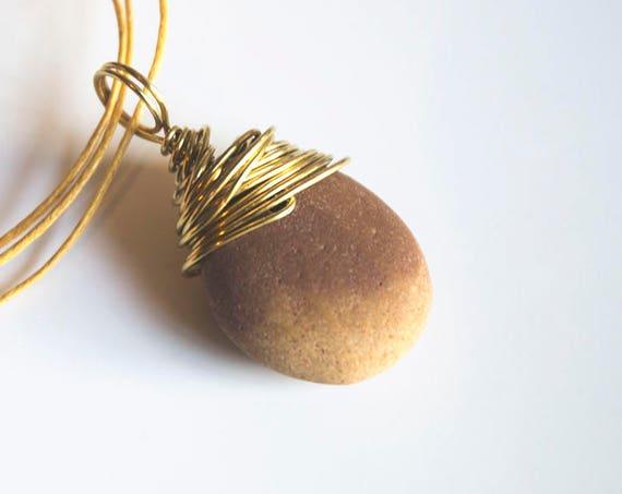 "Messy brass-wrapped beach stone pendant: ""Sunrise"" Natural colour.  Beach, surfer, boho, hippie, druid"