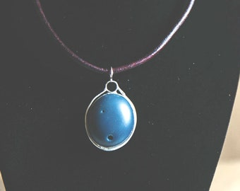 Smooth Beach Stone Pendant in deepest blue, on thick leather rope.