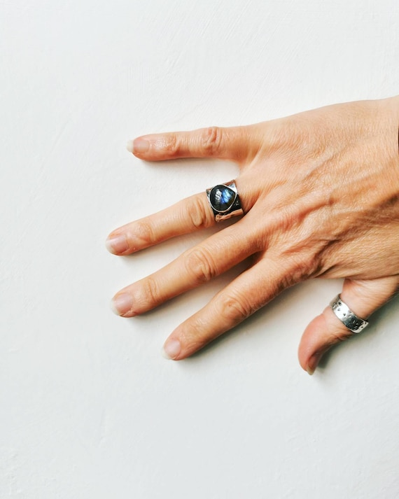 A hammered sterling silver ring set with a labradorite teardrop , size N (UK) 6 1/2 (US)