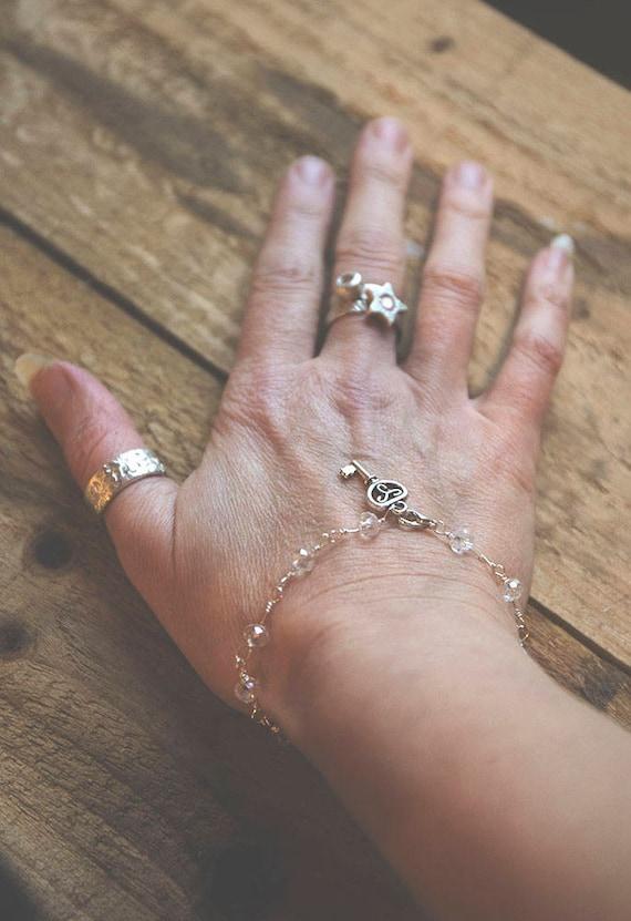 Delicate sterling silver bracelet with Swarovski Crystals.