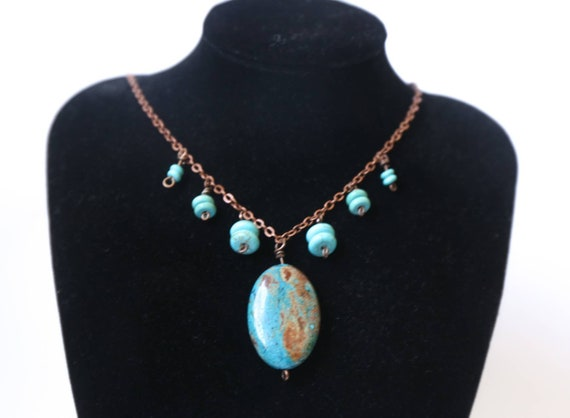 Turquoise necklace on antiqued copper chain.