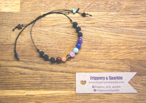 Adjustable Chakra Bracelet - natural stone, lava stone, sterling silver, crystal and rainbow haematite. On black waxed cotton cord.