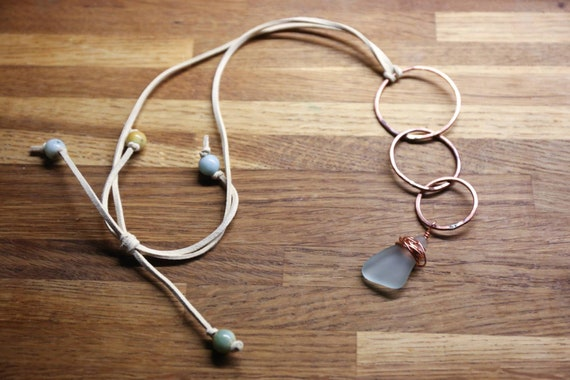 Hammered copper circles with Seaham seaglass and Amazonite Beads. Adjustable necklace. On faux suede.