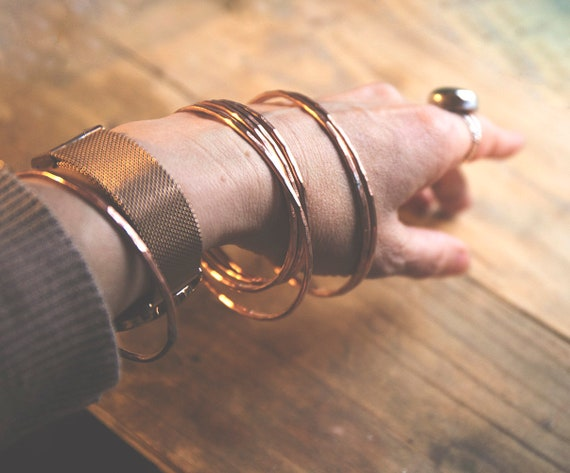 Hammered copper bangles. Two sizes. Sets of three. Elegant simplicity.