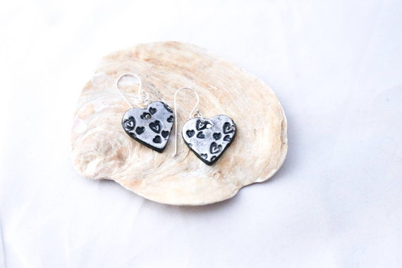 Hand modelled heart shaped earrings, embossed with hearts, sterling earwires