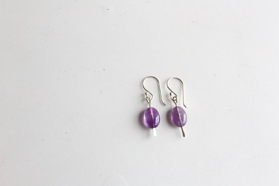 Hammered sterling silver amethyst earrings on sterling silver earwires.