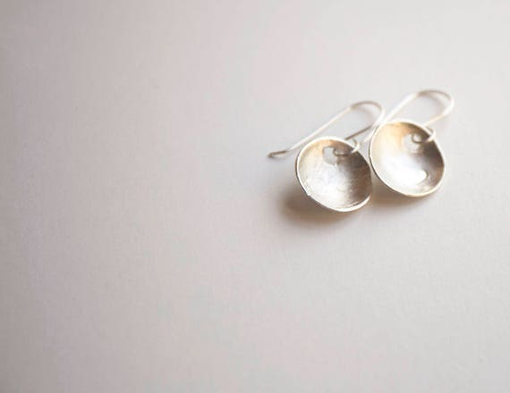 Hand-Fashioned Pure Silver Earrings. Curved discs each embossed with a little heart. One of a kind.